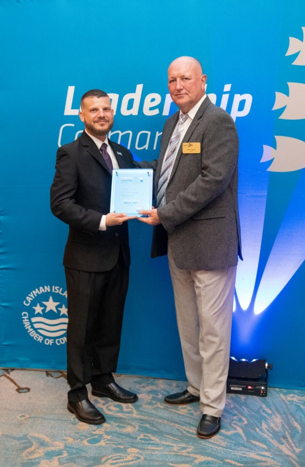 https://www.leadershipcayman.ky/cache/About/616_448/nicholas_mclean_accepting_plaque11626470542.jpg